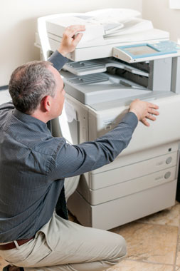 man at copier